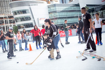 Holiday On Ice 2017 LA Kings Ice Crew and young skater