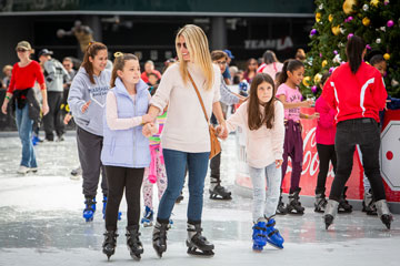 girls skating with mother