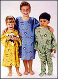 Children in hospital gowns with Looney Tunes characters.